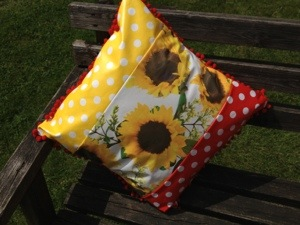 Pom pom oil cloth cushion