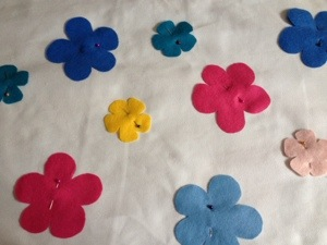 Pinning on the felt flowers