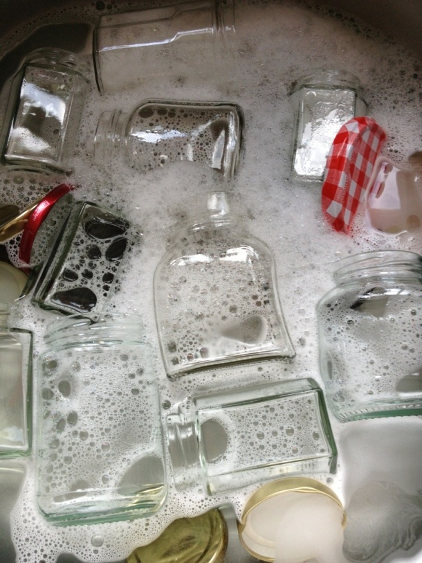 Wash jars and lids in hot soapy water