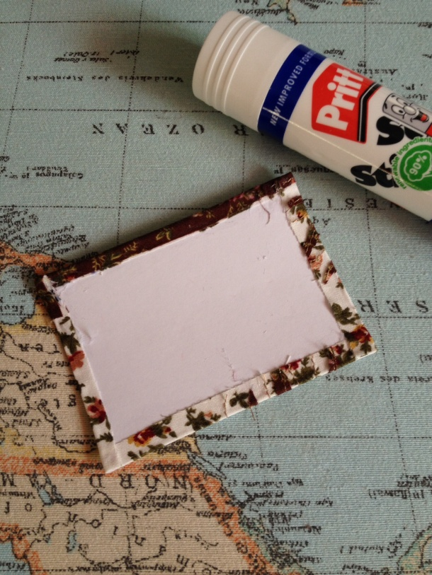I used my old favourite Pritstick to stick the folded edges of fabric onto a piece of light card cut to size.