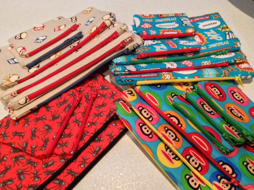 Pencil cases and zipped purses