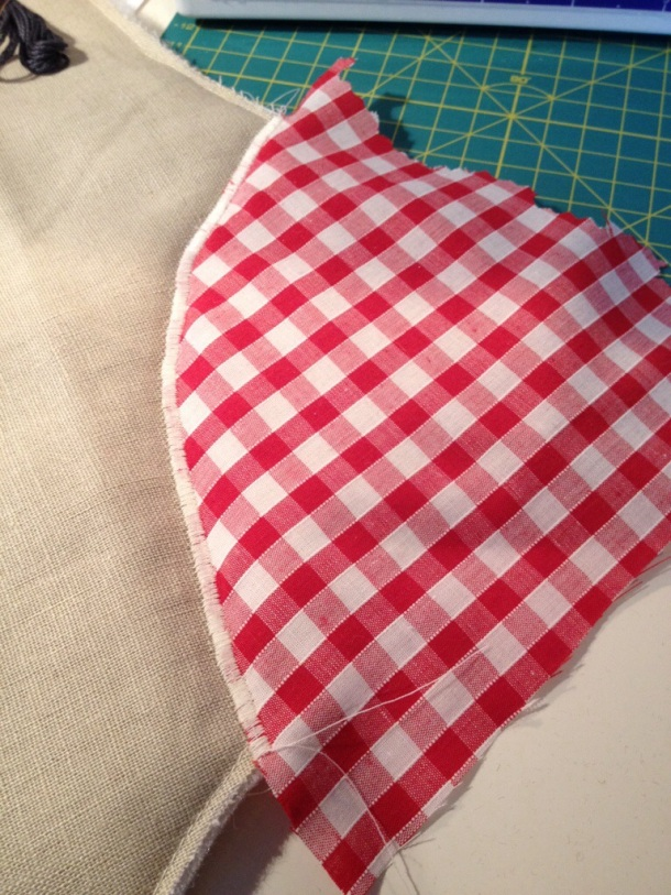 A contrasting patch of gingham sown onto the heel.