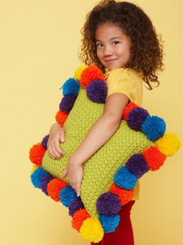 Pompom edged pillow