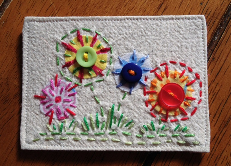 Fabric ATC by patch. Hand embroidered spring flowers.