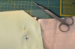 Sewing the lining pieces, right sides together, stopping just short of the hinge mark