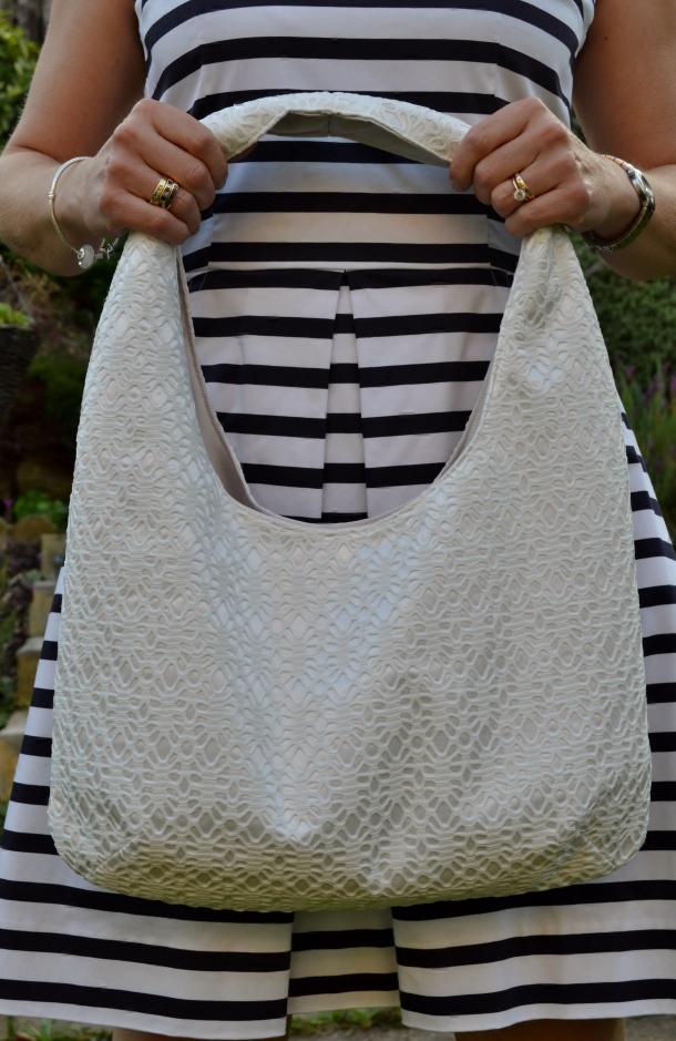 Holiday handbag in bonded white lace, courtesy of White Tree Fabrics