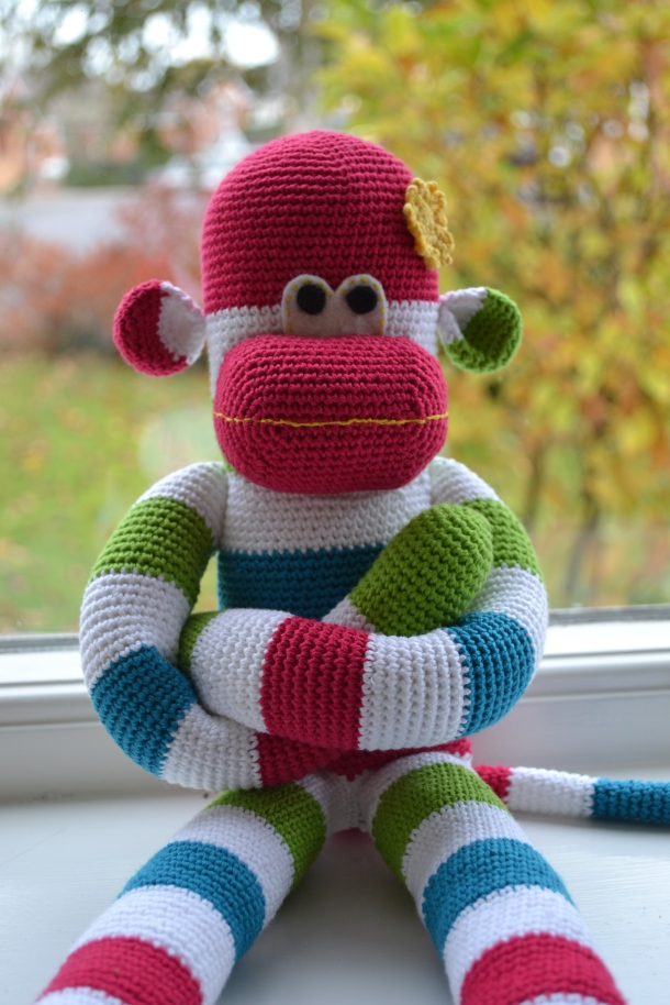Crochet sock monkey.  Pattern by Craft Passion