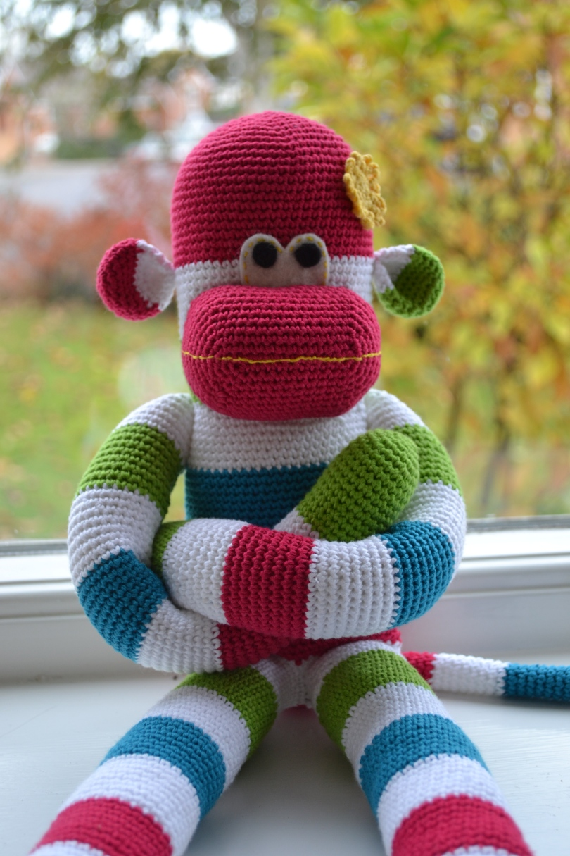 Crochet sock monkey.  Pattern by Craft Passion