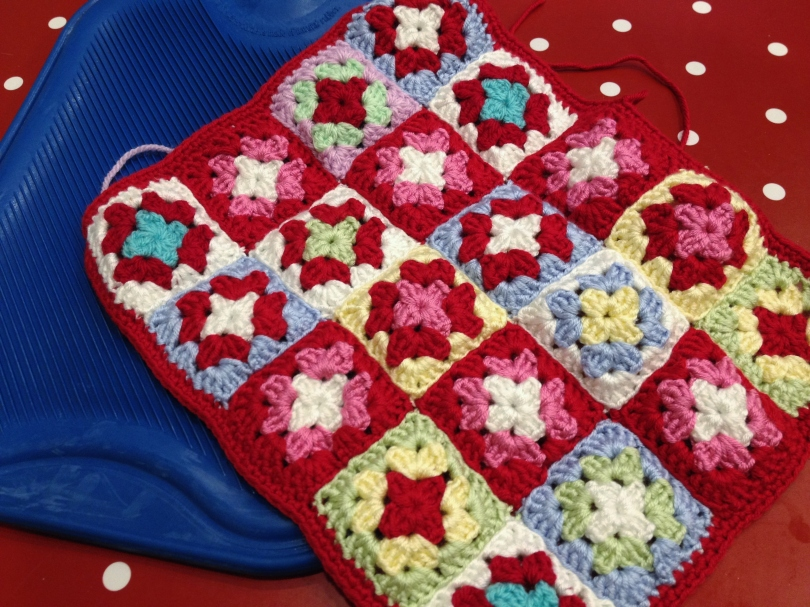 Crochet granny squares. First side assembled
