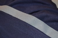 Iron on stretch interfacing to prevent a wibbly hem