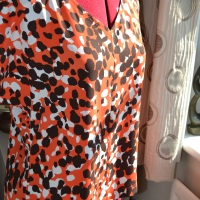 'See me coming' orange blouse