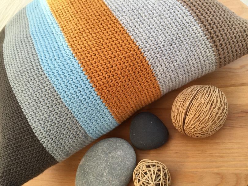 Colour block crochet cushion